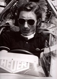 Jo Siffert rocks a checquered flag cravat, with a tennis top and very old-school sunglasses. Jo really had his own little style that was only vaguely to do with the period he lived in. Vintage Cars, Vintage Auto, Tennis Tops, Gilles Villeneuve, Cravat, Black And White Pictures, Formula One, Sport, Le Mans