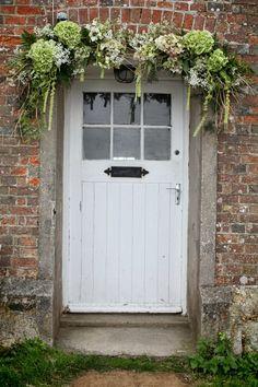 Cottage door with hydrangea garland Cottage Front Doors, Cottage Door, Front Door Colors, Front Door Decor, Back Doors, Entry Doors, Exterior Doors, Garage Door Design, Garage Doors