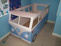 Vw bus bed--Thinking that maybe I could use J's kura bunk bed as a frame to build something like this. How cool would this be in a beach themed room.