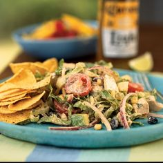 Serve a zesty chicken taco salad drizzled with a chipotle chile, cumin, and cilantro dressing. The smokiness of the chipotle brings out the rich flavors of the roasted chicken breasts.