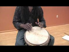 How to Play African Drums : How to Slap a Djembe Drum