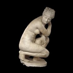 Marble statue of a naked Aphrodite crouching at her bath Roman, 2nd century AD A version of an original from Hellenistic Greece, at British Museum