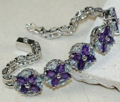 Amethyst Faceted,	Blue Topaz bracelet designed and created by Sizzling Silver. Please visit  www.sizzlingsilver.com. Product code: BR-8849