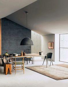 Concrete floor, Grey wall and reclaimed wood block stool, http://www.raftfurniture.co.uk/block-stool.html