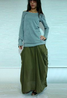 gray blue sweater and green long skirt