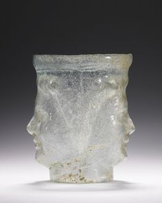 Janus-head flask, 1st century A.D., eastern Mediterranean. Glass, 3 7/16 in. high. The J. Paul Getty Museum, 2003.474 The god Janus has two faces, one looking back at the past, and one looking forward towards the future.