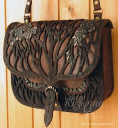 (love the over layering, inspiration for use) Cool integration of tree imagery with leatherwork Leather Carving, Leather Art, Leather Pouch, Leather Tooling, Leather Purses, Tote Handbags, Purses And Handbags, Designer Leather Handbags, Work Bags