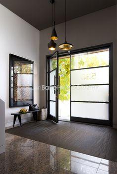 Custom metal door with a privacy film. Foyer Design, Fantasy Rooms, Entry Foyer, Modern Door, Modern House Design, Design Build Firm, Entry Decor, Interior Design Firms, Metal Door