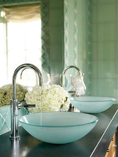 This his/her vanity sink is very modern, with the vessel sinks that also look like art. The chrome faucets also make this space look very modern. http://www.bhg.com/bathroom/sinks/stylish-vessel-sinks/
