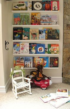 LOVE, LOVE this wall unit!!  It was created by using a blank wall and attaching ledges from Ikea!