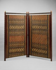 Screen Designed by Lockwood de Forest - With its carved teak frame, vividly patterned plaited matting, and Japanese lacquer and mixed-metal finials, this unusual screen epitomizes the fascination with exotic styles and materials.