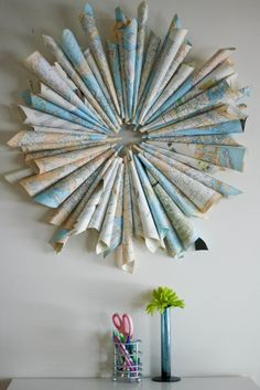 DIY with maps: rolled up map wreath is a gread recycled home decoration out of old maps | decoration . Dekoration . décoration |