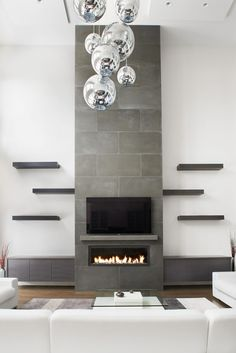Fireplace Design Idea - 6 Different Materials To Use For A Fireplace Surround // Concrete has clean lines and natural finishes, it brings a contemporary feel to an interior and heats up the space as it retains the heat thrown off by the fire.