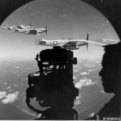 P-51 Mustang fighters seen through a window of a B-29 Superfortress bomber 1945.
