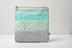 One of my favorite bags on Etsy. SALE Triangle Printed LeatherSuede Pouch aqua by CORIUMI on Etsy, $45.00