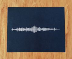'Skinny love' in waveform, white cotton stitched onto black card.