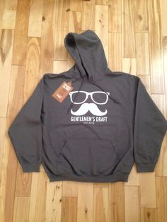 Charcoal Hoodie.  Check out Gentlemen's Draft Clothing at https://www.facebook.com/GentlemensDraft   $2 from each item sold is donated to prostate cancer research.  Join us in  helping to fight cancer, one shirt at a time.   Stay classy like never before with our signature moustache and glasses logo on our custom designed threads.   Also check us out on: Instagram - gentlemens_draft