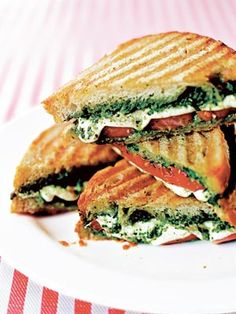 This simple and fresh sandwich combines mouthwatering beefsteak tomatoes, fresh mozzarella, and basil pesto. Pesto Panini Recipe, Panini Recipes, Food Network Recipes, Gourmet Recipes, Mexican Food Recipes, Cooking Recipes, Wrap Recipes, Healthy Sandwiches, Wrap Sandwiches