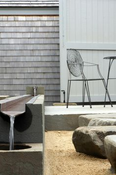 Oh, this alongside/above the retaining wall for walk out. Linked to gutter? contemporary patio by Workshop/apd