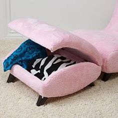 Your child will enjoy this unique shape chair and storage ottoman. Softly padded on all sides and a light pink color, this ottoman will bring fun style to your child's room.