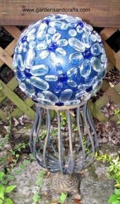 recycled garden art | Garden sculpture: recycled marbles and bowling ball mosaic. Cracked ...