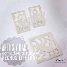 Aretes en plata con cortes hechos a mano