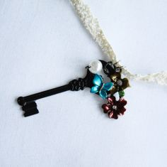 The Secret Garden necklace is bursting with joy at the arrival of spring!  Hello sunshine and fresh flowers!