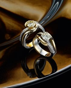 two 18k yellow and white gold diamond rings
