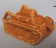 Made by Wadeheath circa 1930 a WW1 tank teapot. Sold on ebay 6th March 2008 for £77