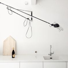 Someone is about to celebrate their new 265 light from Flos with a nice bottle of bubbly