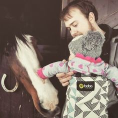 Daddy, baby, horsy bonding time. Aren't babywearing dads the best?