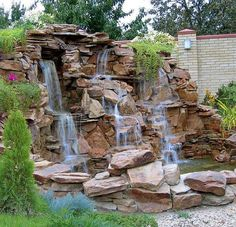 A collection of large and small backyard pond ideas and designs. in a series of photographs. includes koi ponds, Japanese ponds, terraced ponds and more. Garden Waterfall, Waterfall Fountain, Backyard Water Feature, Ponds Backyard, Koi Ponds, Garden Water Fountains, Water Garden, Pond Design, Landscape Design