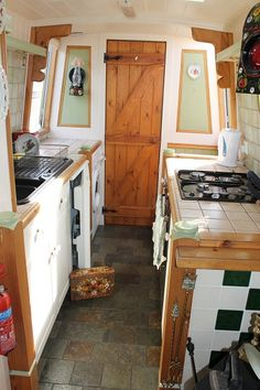 Most of the boat kitchens I see have a full depth counter on one side and a half depth one on the other. The math for two full counters does work though (this is the NB Taurus). Narrowboat Kitchen, Narrowboat Interiors, Living On A Boat, Tiny Living, Sailboat Living, Galley Kitchens, Cool Kitchens, Canal Boat Interior, Wooden Shack