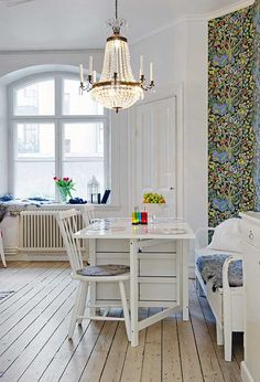 Swedish Apt ~ c/o freshome  window & wallpaper lovely.  Can't see it in this photo but there is a multicoloured rag rug that reminds me of my mummy.