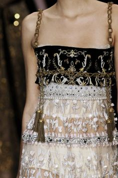Dolce & Gabbana. Inspiration for layering vintage fabrics and antique lace.  Great idea to use necklace, belt or other jewelry for straps.