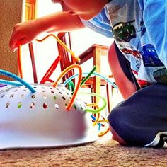Keep your toddler entertained with little more than a colander and some pipe cleaners. | 28 Genius Hacks Every Lazy Parent Needs To Know