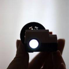 A mini projector to relive the old times with friends Tiny Instagram, Smile And Wave, Exhibition Display, Just For Fun, Best Gifts, Wall Lights, Old Things, Battery Operated, Cool Stuff
