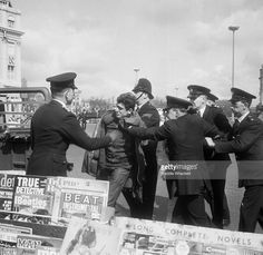 A mod being arrested in Brighton after clashes with rockers.