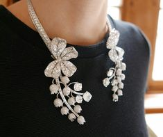 Modelled as a lily of the valley blossom, this exquisite articulated necklace with en tremblant flowers, set with old and baguette-cut diamonds is certainly one of Paul Flato's more impressive statement jewels.  #christies #jewellery #luxury