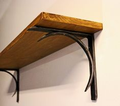 these shelf brackets are hand forged in iron by one of our blacksmiths after