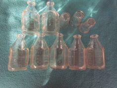 antique pink glass baby bottles