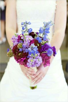 Blue Delphinium, Blue Cornflower, Lavender Stock, Red-Violet Chrysanthemums, Purple Lisianthus, Burgundy Ranunculus, Fuchsia Filler & Scabiosa Pods Bride's Bouquet••••