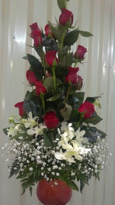 IMAGE of Red Roses, in red vase with baby breath