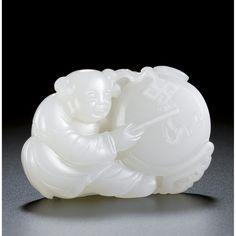 A FINE WHITE JADE CARVING OF A BOY WITH A DRUM<br>QING DYNASTY, 18TH CENTURY | Lot | Sotheby's