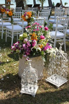 Aisle flowers with birdcages http://www.weddings-koh-samui.com/