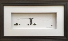 8 by 15  Pebble art comes framed with mat and glass
