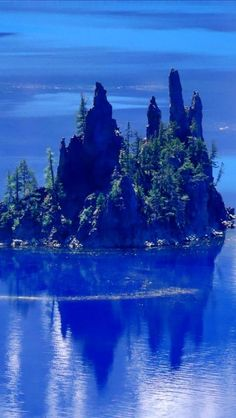 Phantom Ship island , Crater Lake , U.S. state of Oregon, as cool in real life as this picture!  Lots of mystic places in the Northwest...