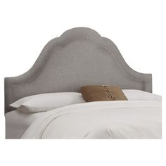 Nailhead-trimmed high arch headboard with a pine wood frame and foam cushioning. Handmade in the USA.  Product: Headboard