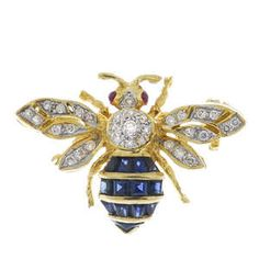 LOT:625   A sapphire, diamond and ruby bee brooch.