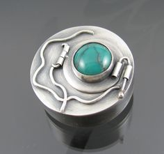 BAD12 - hollowform vine locket. Sterling silver and turquoise. Can be worn as a brooch or a necklace.